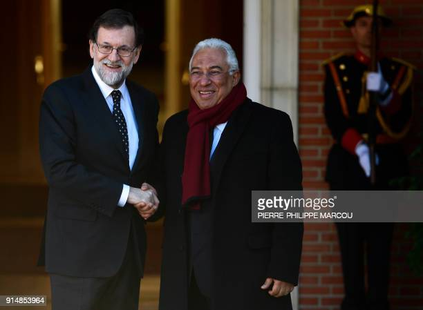 Spanish Prime minister Mariano Rajoy shakes hands with Portuguese counterpart Antonio Costa at 'La Moncloa' palace in Madrid on February 6, 2018. /...