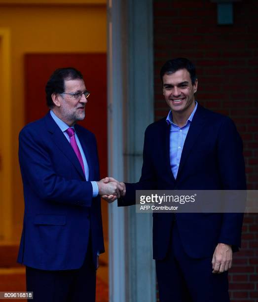 Spanish Prime Minister Mariano Rajoy shakes hands with the leader of Spanish Socialist Party , Pedro Sanchez at La Moncloa palace in Madrid on July...
