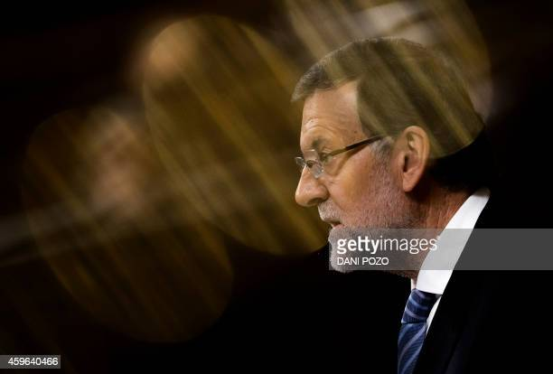 Spanish Prime Minister Mariano Rajoy speaks during a control session at the Spain's Lower House of the parliament in Madrid on November 27 2014 Rajoy...