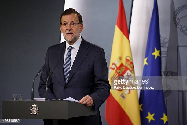 Spanish Prime Minister Mariano Rajoy speaks during a press conference after a gabinet meeting at Moncloa Palace on September 29 2014 in Madrid Spain...