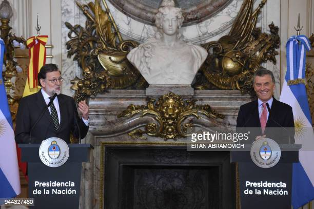 Spanish Prime Minister Mariano Rajoy speaks next to Argentinian President Mauricio Macri during a joint press conference at the Casa Rosada...