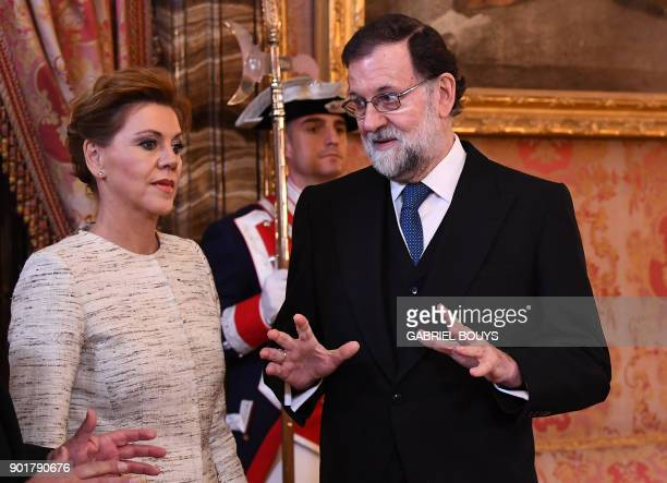 Spanish Prime Minister Mariano Rajoy speaks with Spain's Defence Minister Maria Dolores de Cospedal during the Epiphany Day celebrations at the Royal...