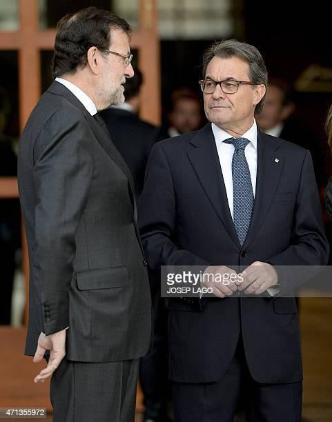 Spanish Prime Minister Mariano Rajoy talks to Catalonia's regional president Artur Mas at the Sagrada Familia's basilica in Barcelona on April 27,...