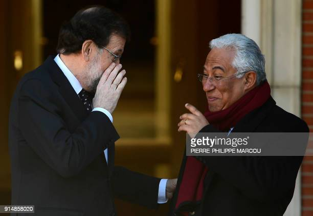 Spanish Prime minister Mariano Rajoy talks wit his Portuguese counterpart Antonio Costa before holding a meeting at 'La Moncloa' palace in Madrid on...