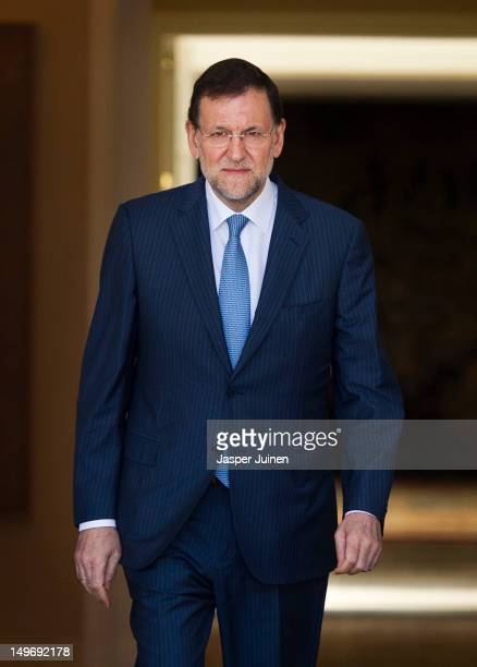 Spanish Prime Minister Mariano Rajoy walks out of La Moncloa palace to welcome his Italian counterpart Prime Minister Mario Monti on August 2 2012 in...