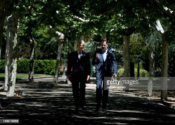 Spanish Prime Minister Mariano Rajoy walks the premises of the Moncloa palaca with his Italian counterpart Prime Minister Mario Monti on August 2...