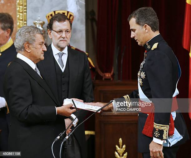 Spanish Prime Minister Mariano Rajoy watchs as President of the Congress of Deputies Jesus Maria Posada Moreno conducts the oath on Spain's King...