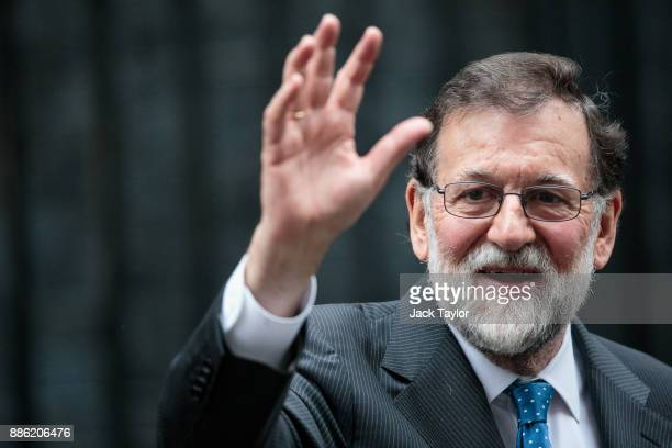 Spanish Prime Minister Mariano Rajoy waves as he leaves Number 10 Downing Street following a meeting with British Prime Minister Theresa May on...