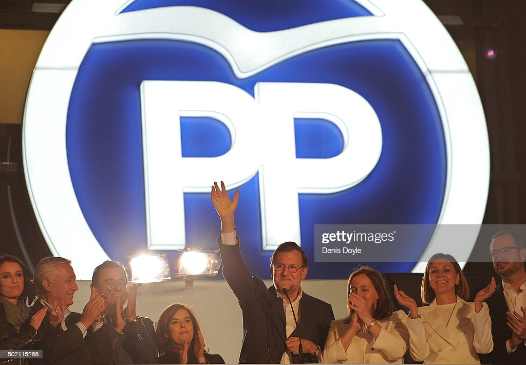 Spanish Prime Minister Mariano Rajoy waves to supporters from the balcony at Popular Party headquarters after his party won the most votes during General Elections on December 20, 2015 in Madrid, Spain. Spaniards went to the polls today to vote for 350 members of the parliament and 208 senators. For the first time since 1982, the two traditional Spanish political parties, right-wing Partido Popular (People's Party) and centre-left wing Partido Socialista Obrero Espanol PSOE (Spanish Socialist Workers' Party), held a tight election race with two new contenders, Ciudadanos (Citizens) and Podemos (We Can) attracting right-leaning and left-leaning voters respectively.