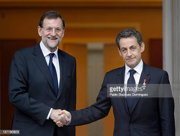 Spanish Prime Minister Mariano Rajoy welcomes French President Nicolas Sarkozy before a meeting at the Moncloa Palace on January 16 2012 in Madrid...