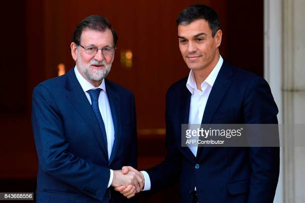 Spanish Prime Minister Mariano Rajoy welcomes Pedro Sanchez the leader of Spanish Socialist Party at La Moncloa palace in Madrid on September 7 2017...