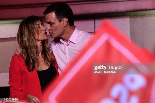 Spanish Prime Minister Pedro and Socialist Party candidate for prime minister Pedro Sanchez kisses his wife Begona Gomez during an election night...