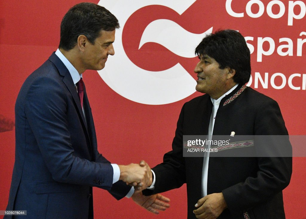 Spanish prime minister pedro sanchez l and bolivian president evo spanish prime minister pedro sanchez l and bolivian president evo morales greet each other m4hsunfo
