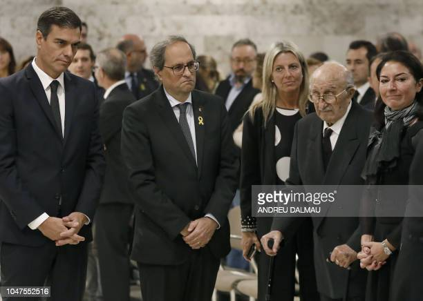 Spanish prime minister Pedro Sanchez and Catalan regional president Quim Torra look at Bernabe Martinez the widower of Spanish opera singer...