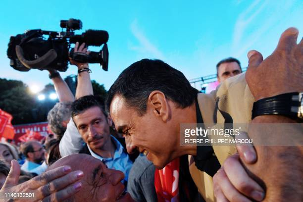 Spanish Prime Minister Pedro Sanchez greets supporters during a Spanish Socialist Party campaign rally in Madrid on May 24 2019 ahead of local and EU...