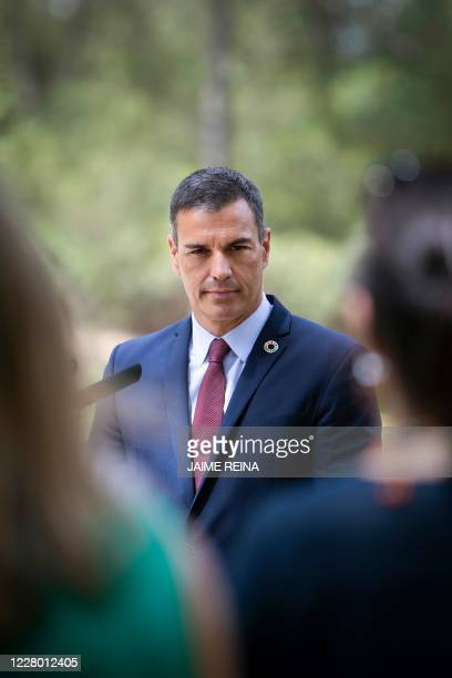 Spanish Prime Minister Pedro Sanchez holds a press conference following a meeting with the Spanish king at the royal family's summer residence at the...