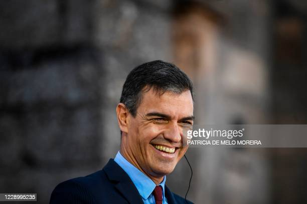 Spanish Prime Minister Pedro Sanchez laughs during a press conference with his Portuguese counterpart at the 31st Portuguese-Spanish summit this year...
