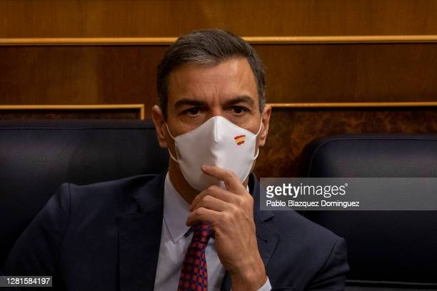 Spanish Prime Minister Pedro Sanchez looks on during a debate on a noconfidence motion at the Lower House of the Spanish Parliament on October 22...