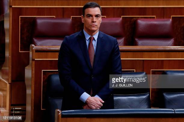 Spanish Prime Minister Pedro Sanchez observes a minute of silence during a session to debate the extension of a national lockdown to curb the spread...