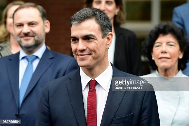 Spanish Prime Minister Pedro Sanchez poses with his new ministers for a family photo following their first cabinet meeting at La Moncloa palace in...
