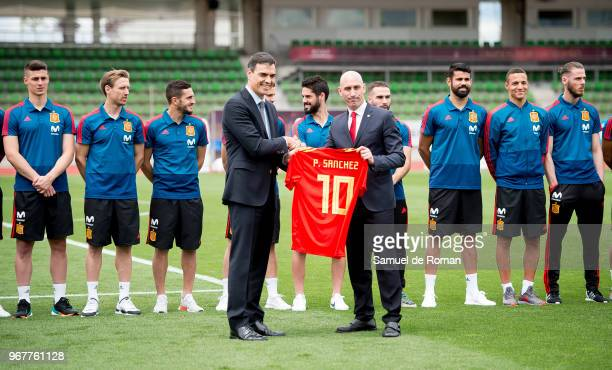 Spanish Prime Minister Pedro Sanchez receives a jersey with his name on from the Spanish Royal Footbal Federation president Luis Manuel Rubiales...