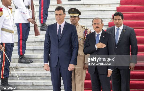Spanish Prime Minister Pedro Sanchez receives honors upon his arrival at the National Palace with Dominican President Danilo Medina , in Santo...