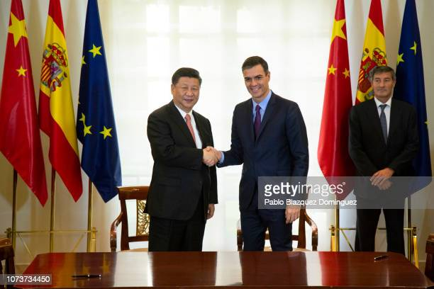 Spanish Prime Minister Pedro Sanchez shakes hands with Chinese President Xi Jinping after signing agreements between both countries at Moncloa Palace...
