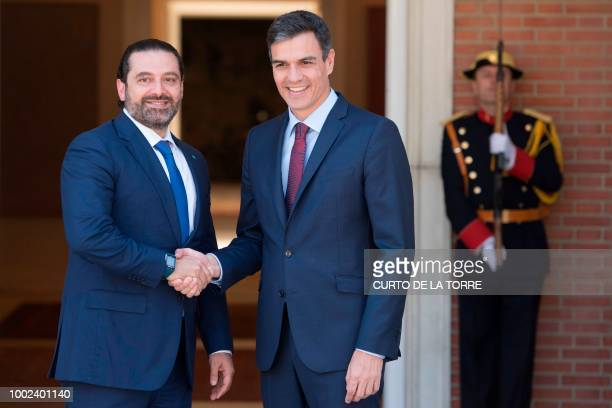 Spanish Prime Minister Pedro Sanchez shakes hands with his Lebanese counterpart Saad Hariri upon his arrival for a meeting at the Moncloa Palace in...