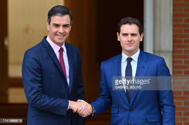 Spanish prime minister Pedro Sanchez shakes hands with the leader of Ciudadanos party Albert Rivera prior to holding a meeting at La Moncloa Palace...