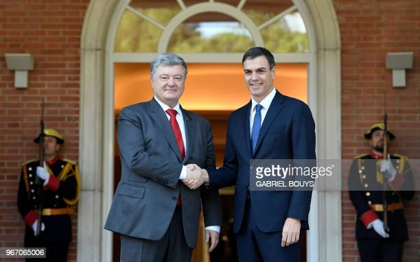 Spanish prime minister Pedro Sanchez shakes hands with Ukrainian president Petro Poroshenko prior to holding a meeting at La Moncloa palace in Madrid...
