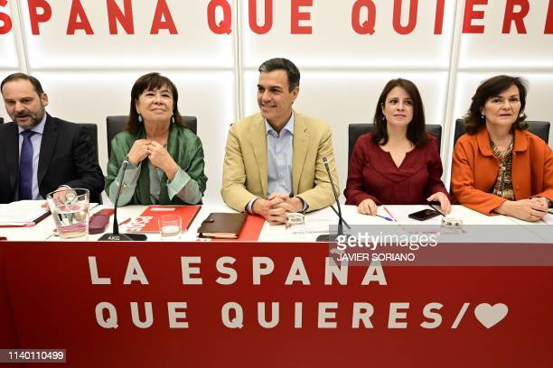 Spanish Prime Minister Pedro Sanchez sits between Socialist Party organisational secretary Jose Luis Abalos party president Cristina Narbona party...