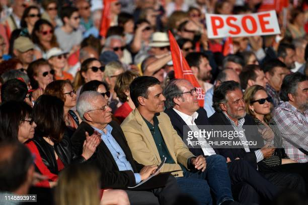 Spanish Prime Minister Pedro Sanchez sits with EU candidate Josep Borrell candidate for Madrid's regional government Angel Gabilondo and the...