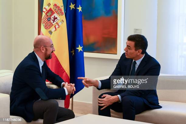 Spanish Prime Minister Pedro Sanchez speaks with European Council president elect Charles Michel during a meeting at the Moncloa Palace in Madrid, on...
