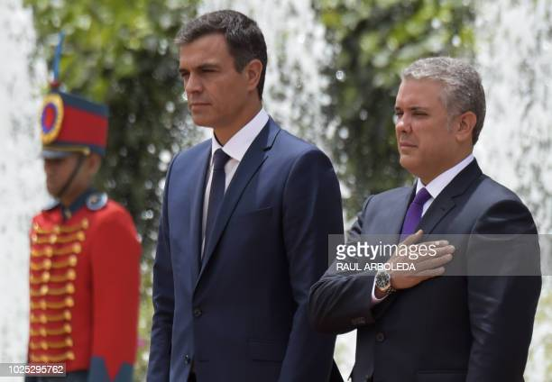 Spanish Prime Minister Pedro Sanchez stands next to Colombian president Ivan Duque at Casa Narino palace during the two day official visit in Bogota...