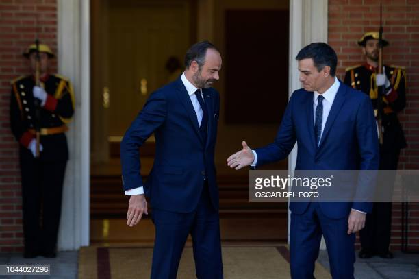 Spanish Prime Minister Pedro Sanchez welcomes French Prime Minister Edouard Philippe at the Moncloa Palace in Madrid on October 1 before a meeting to...