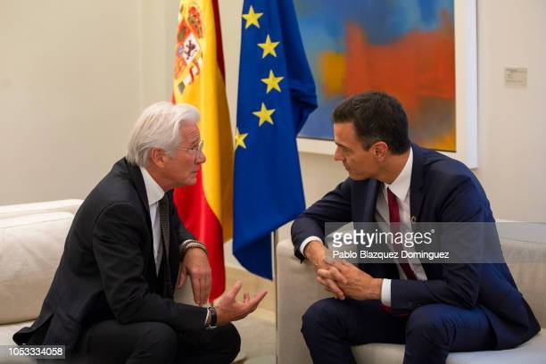 Spanish Prime Minister Pedro Sanchezc speaks with US actor and activist Richard Gere during a meeting with Fundacion RAIS representatives at Moncloa...