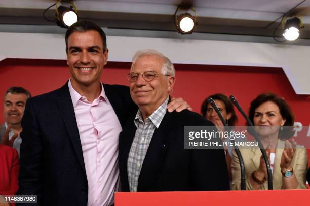 Spanish prime minister socialist Pedro Sanchez smiles with current Spanish minister of foreign affairs and EU socialist candidate Josep Borrell...