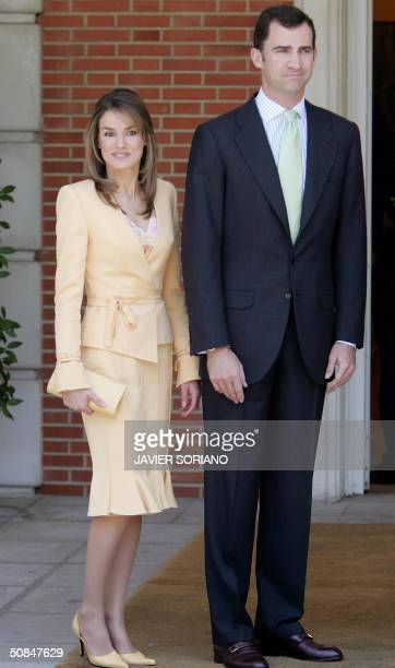 Spanish Prince Felipe and his fiancee Letizia Ortiz poses before the lunch offered by the government at Moncloa Palace in Madrid 17 May 2004 AFP...