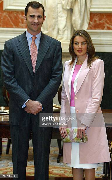 Spanish Prince Felipe poses with his fiancee Letizia Ortiz in the Spanish Parliament 03 may 2004 after they signed the guest book in Madrid AFP...
