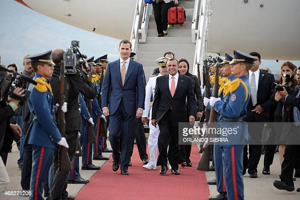 Spanish Prince of Asturias Felipe de Borbon is accompanied by Honduran President Porfirio Lobo upon his arrival at Palmerola military base in...