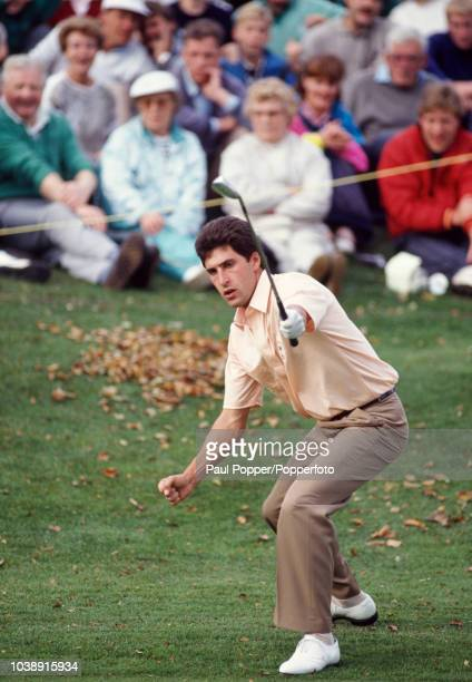 Spanish professional golfer Jose Maria Olazabal reacts after missing a putt on the 10th green during play for Team Europe against Team USA in the...