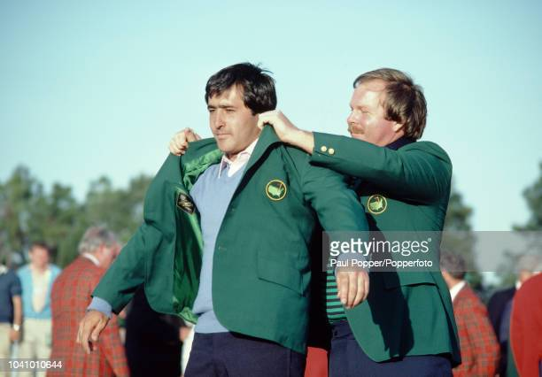 Spanish professional golfer Seve Ballesteros receives the green jacket from Craig Stadler of the United States after finishing in first place to win...