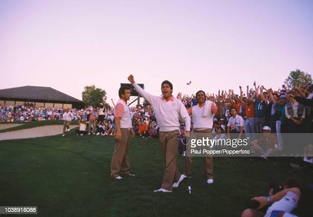 Spanish professional golfers Jose Maria Olazabal and Seve Ballesteros celebrate with Team Europe captain Tony Jacklin after teammate Bernhard Langer...