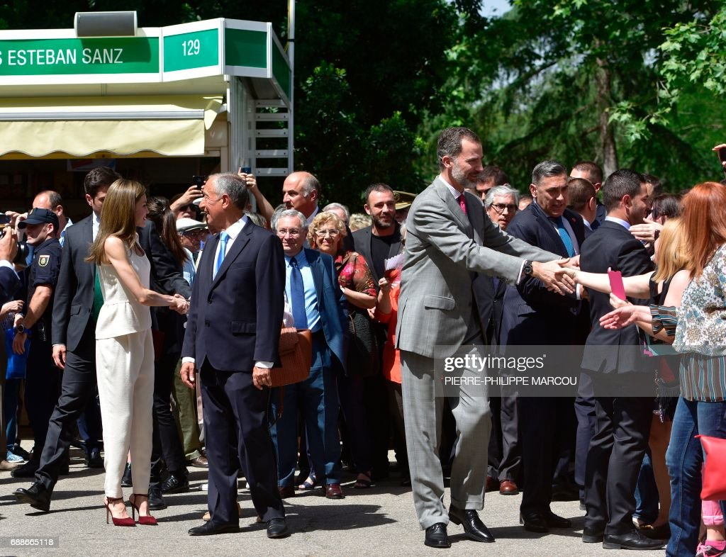 Spanish queen letizia l portuguese president marcelo rebelo de spanish queen letizia l portuguese president marcelo rebelo de sousa c and king felipe vi of spain greet the public as they visit the madrid book fair m4hsunfo