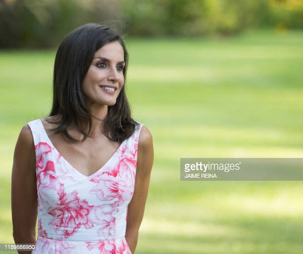 Spanish Queen Letizia poses in the gardens at the Marivent palace on the island of Majorca on August 4 2019 The Spanish royal family traditionally...