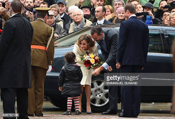 Spanish Queen Letizia receives flowers a young girl as she is welcomed with her husband Spanish King Felipe VI by Grand Duke Henri of Luxembourg ,...