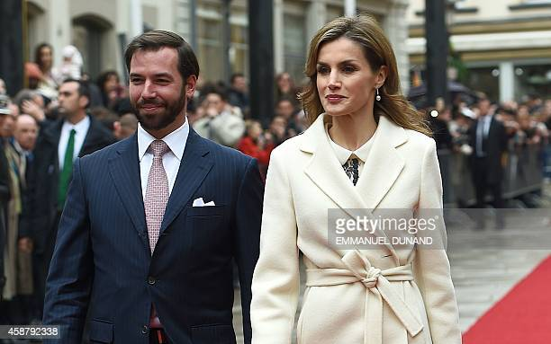 Spanish Queen Letizia walks with Crown Prince Guillaume of Luxembourg during an official welcoming ceremony at the GrandDucal Palace in Luxembourg on...