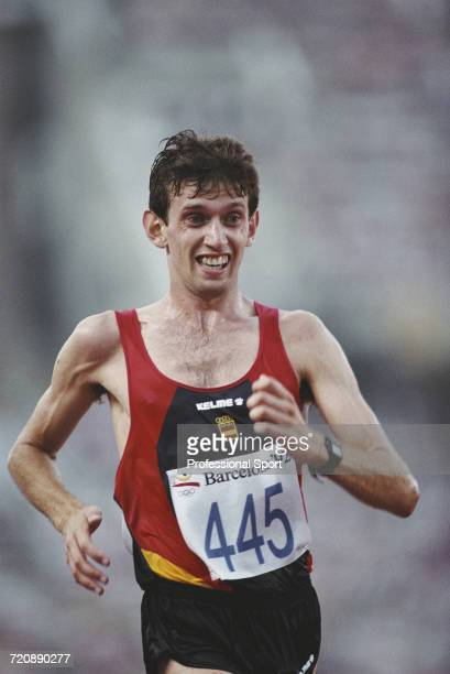 Spanish race walker Daniel Plaza competes for the Spain team to cross the finish line in first place to win the gold medal in the Men's 20 kilometres...