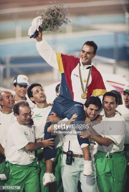 Spanish racing cyclist Jose Manuel Moreno is held aloft by team mates and Spanish Olympic team officials after competition to finish in first place...