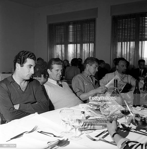 Spanish racing driver Alfonso de Portago and German racing driver Wolfgang von Trips sitting at the table in the training camp with Ferrari racing...